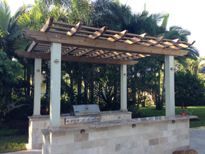 free-standing outdoor kitchen with pergola above