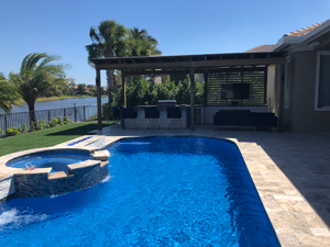 view of deck with swimming pool and pergola in the background