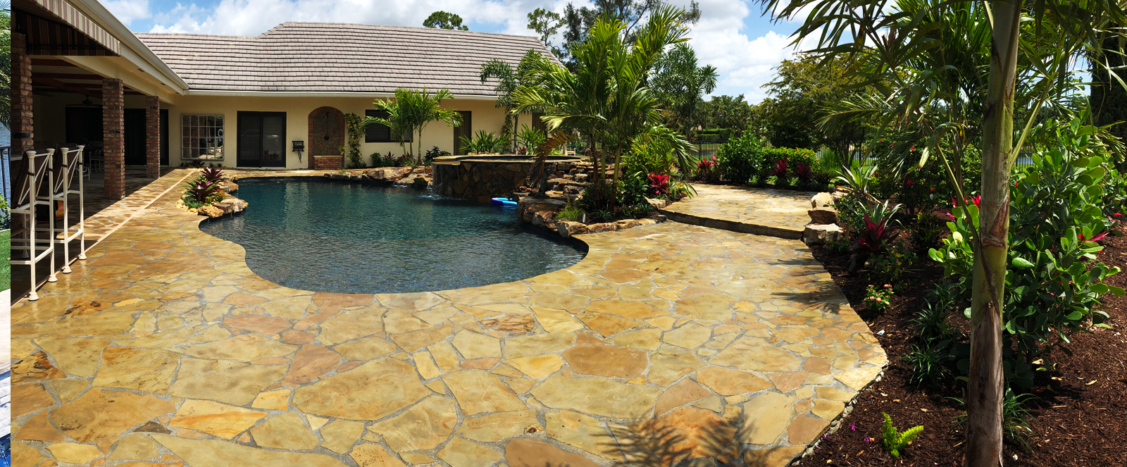 backyard with large size tile deck with swimming pool